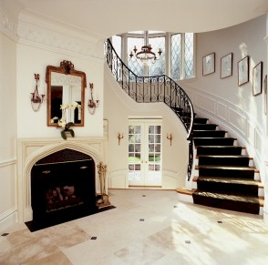 Stairway Collection - Custom Curved Wood Stairs with wrought iron
