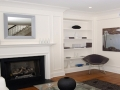 White contemporary Luxury Condo with Fireplace by Connaughton Construction