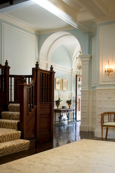 Ornate wood Stairway to Dining Room in this Historic Home by Connaughton Construction