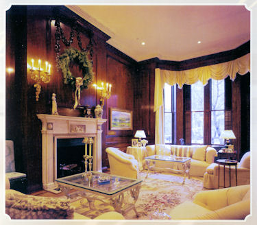 Formal Living Room with Fireplace and warm wood paneled walls by Connaughton Construction